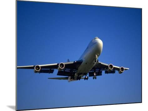Commercial Airplane in Flight-Mitch Diamond-Mounted Photographic Print