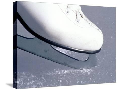 Close-up of Figure Skate on Ice-Ken Wardius-Stretched Canvas Print