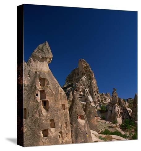 Cone Tufa Buildings, Uchisar, Cappadocia, Turkey-Walter Bibikow-Stretched Canvas Print