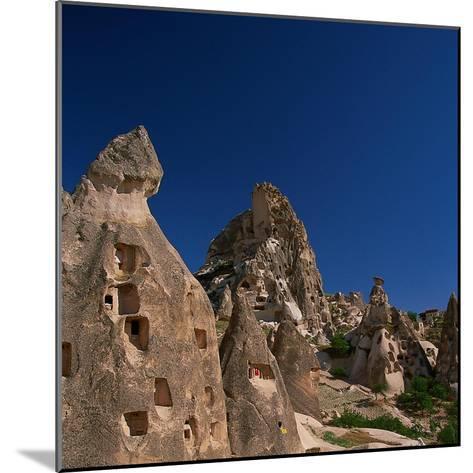 Cone Tufa Buildings, Uchisar, Cappadocia, Turkey-Walter Bibikow-Mounted Photographic Print