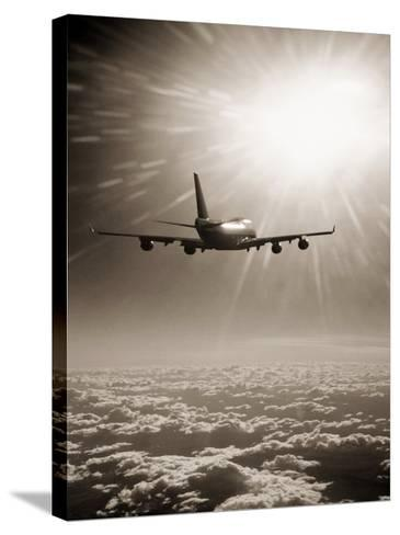 Airplane Flying Through Clouds-Peter Walton-Stretched Canvas Print
