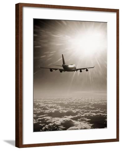 Airplane Flying Through Clouds-Peter Walton-Framed Art Print