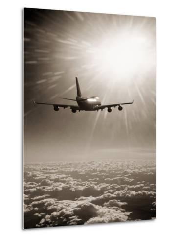 Airplane Flying Through Clouds-Peter Walton-Metal Print