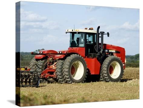 4 Wheel Drive Tractor Pulling a Disc Harrow, Cotswolds, England-Martin Page-Stretched Canvas Print
