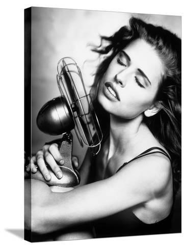 Portrait of a Woman Cooling Herself with a Fan--Stretched Canvas Print