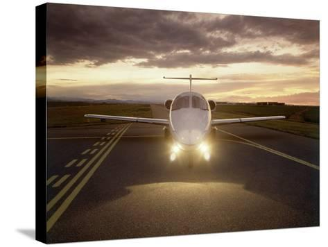 Corporate Jet on Runway-Stephen Collector-Stretched Canvas Print