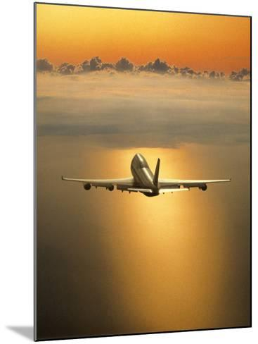 Airplane Flying Through Clouds-Peter Walton-Mounted Photographic Print