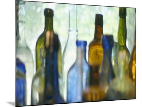 Abstract of Glass Bottles in Window-John Glembin-Mounted Photographic Print