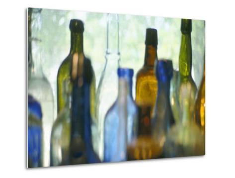 Abstract of Glass Bottles in Window-John Glembin-Metal Print