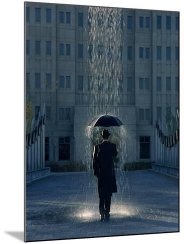 Man with Umbrella Under a Regional Rain-Joseph Hancock-Mounted Photographic Print