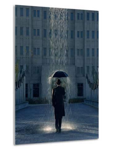 Man with Umbrella Under a Regional Rain-Joseph Hancock-Metal Print