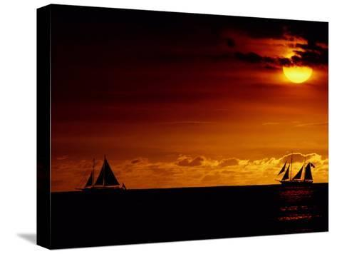 Sailboats Silhouetted on the Pacific Ocean at Twilight-Robert Madden-Stretched Canvas Print