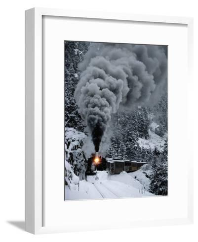 A Train Chugs Through the Snow Blanketing the San Juan Mountains-Paul Chesley-Framed Art Print