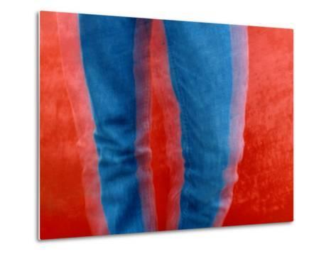 Vibrant Blue Jeans against a Red Background-Raymond Gehman-Metal Print