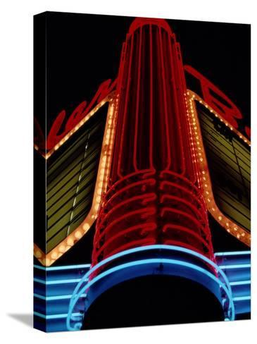 Colorful Neon Centerpiece on the Art Deco Facade a Theater-Stephen St^ John-Stretched Canvas Print