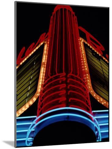 Colorful Neon Centerpiece on the Art Deco Facade a Theater-Stephen St^ John-Mounted Photographic Print