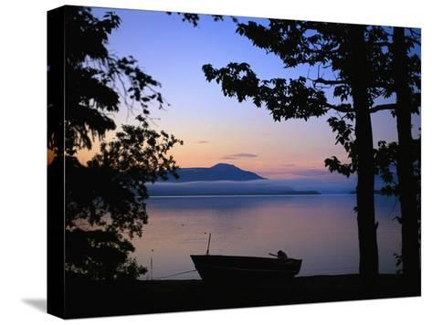 Silhouette of a Motor Boat on the Shores of a Bay in Alaska-Joel Sartore-Stretched Canvas Print