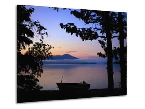 Silhouette of a Motor Boat on the Shores of a Bay in Alaska-Joel Sartore-Metal Print