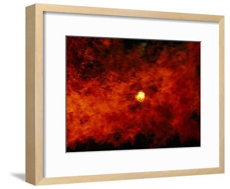 The Sun Peeks Through a Wall of Flame-Raymond Gehman-Framed Art Print