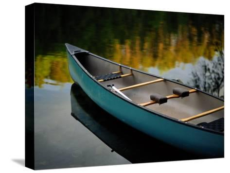 Canoe and Reflections on a Still Lake-Raymond Gehman-Stretched Canvas Print