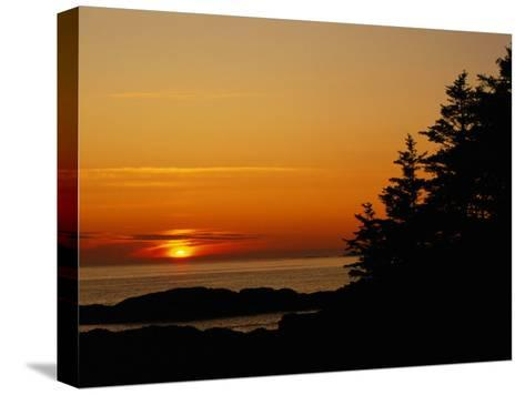 Sunset over a Northern Lake-Raymond Gehman-Stretched Canvas Print