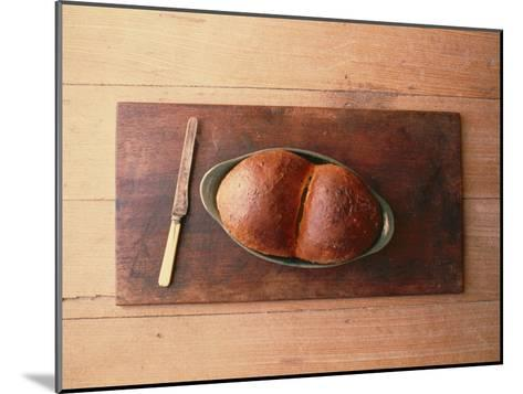 Bread Laid out on a Simple Table Setting-Sam Abell-Mounted Photographic Print