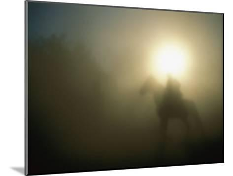 A Person on a Horse is Silhouetted in the Fog-Sisse Brimberg-Mounted Photographic Print