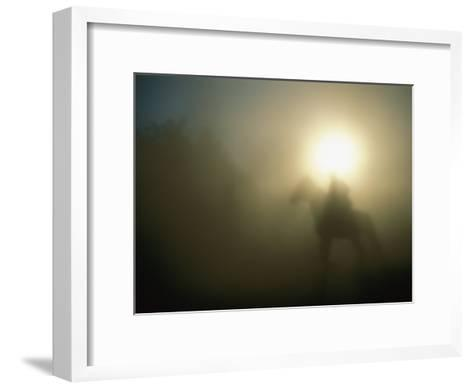 A Person on a Horse is Silhouetted in the Fog-Sisse Brimberg-Framed Art Print