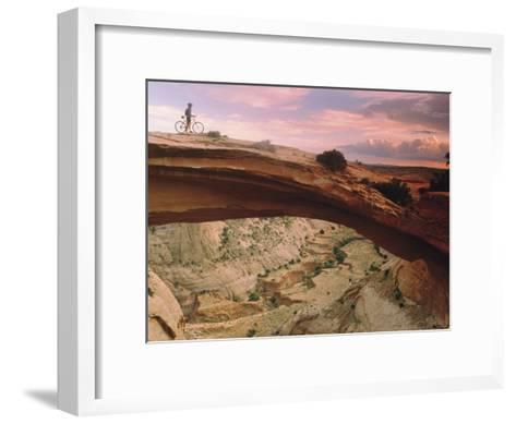 Mountain-Biking over a Natural Arch-Kate Thompson-Framed Art Print