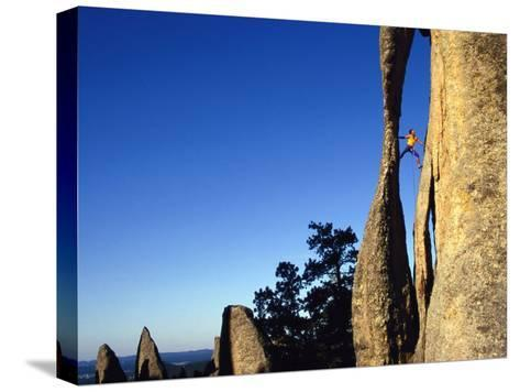 A Climber Leads a Route at the Needles in South Dakota-Bill Hatcher-Stretched Canvas Print
