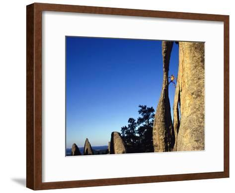 A Climber Leads a Route at the Needles in South Dakota-Bill Hatcher-Framed Art Print