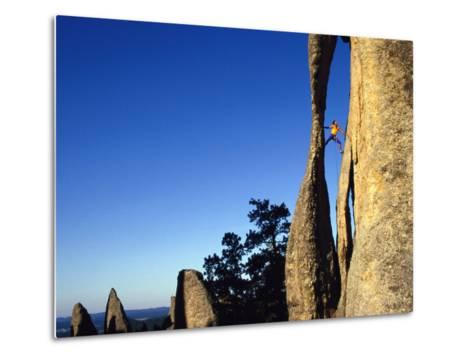 A Climber Leads a Route at the Needles in South Dakota-Bill Hatcher-Metal Print