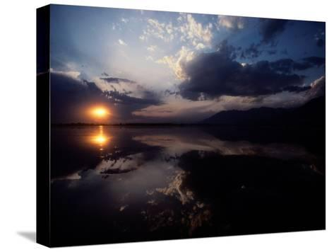 Sunset Sky Filled with Clouds is Reflected in the Water-Sam Abell-Stretched Canvas Print