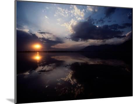 Sunset Sky Filled with Clouds is Reflected in the Water-Sam Abell-Mounted Photographic Print