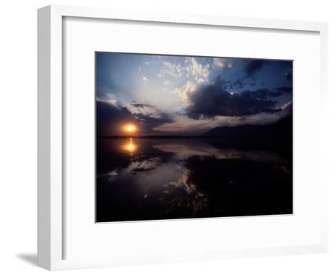 Sunset Sky Filled with Clouds is Reflected in the Water-Sam Abell-Framed Art Print