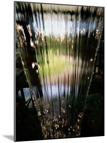 A Sheet of Water Cascading Down an Indoor Waterfall-Raymond Gehman-Mounted Photographic Print
