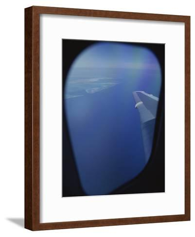 A View out of an Airplane Window over Water and Nearby Islands-Roy Gumpel-Framed Art Print