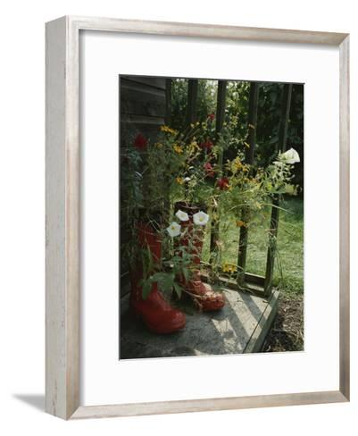 Flowers Bloom from an Unlikely Place-A Pair of Red Boots on a Porch-Jonathan Blair-Framed Art Print