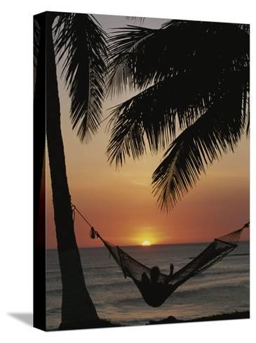 Sunset on Beach with Silhouetted Hammock and Palms, Costa Rica-Michael Melford-Stretched Canvas Print