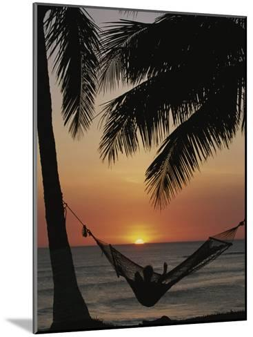 Sunset on Beach with Silhouetted Hammock and Palms, Costa Rica-Michael Melford-Mounted Photographic Print