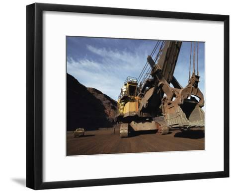A Power Shovel Towers over a Truck and Men-Medford Taylor-Framed Art Print