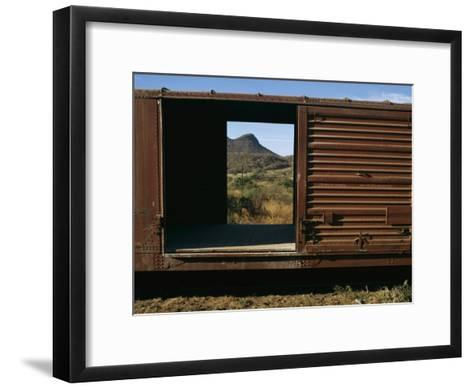 A View of a Distant Hill Through the Door of a Railway Car-Tim Laman-Framed Art Print