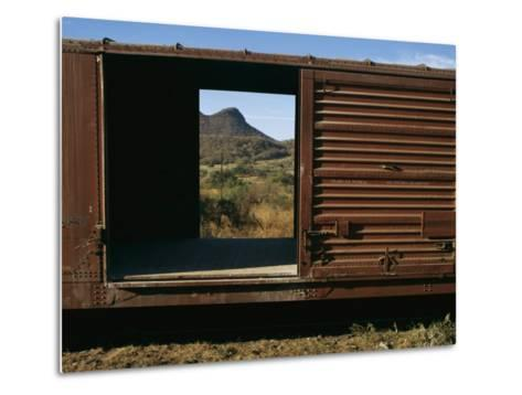 A View of a Distant Hill Through the Door of a Railway Car-Tim Laman-Metal Print