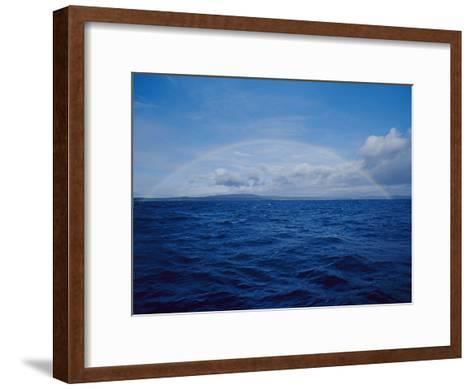 A Rainbow Rises over the Waters Surface in Twofold Bay-Jason Edwards-Framed Art Print