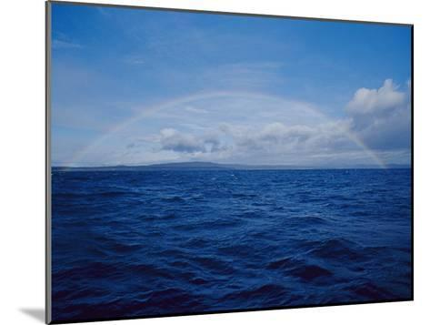 A Rainbow Rises over the Waters Surface in Twofold Bay-Jason Edwards-Mounted Photographic Print