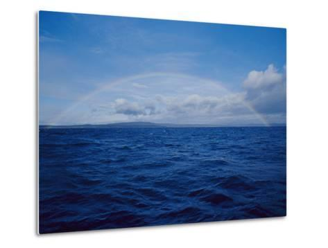 A Rainbow Rises over the Waters Surface in Twofold Bay-Jason Edwards-Metal Print