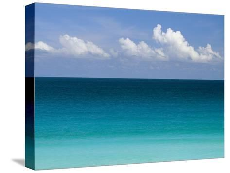 Clear Blue Water and White Puffy Clouds Along the Beach at Cancun-Michael Melford-Stretched Canvas Print