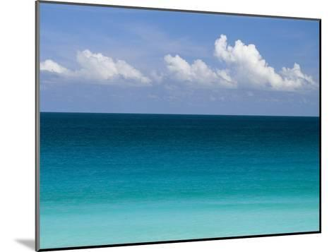 Clear Blue Water and White Puffy Clouds Along the Beach at Cancun-Michael Melford-Mounted Photographic Print