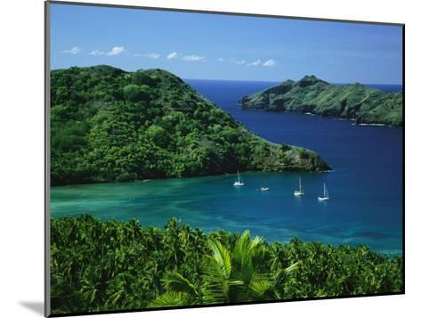 Sailboats Anchored in a Cove of Blue Water on an Asian Island-Tim Laman-Mounted Photographic Print