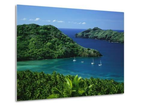 Sailboats Anchored in a Cove of Blue Water on an Asian Island-Tim Laman-Metal Print